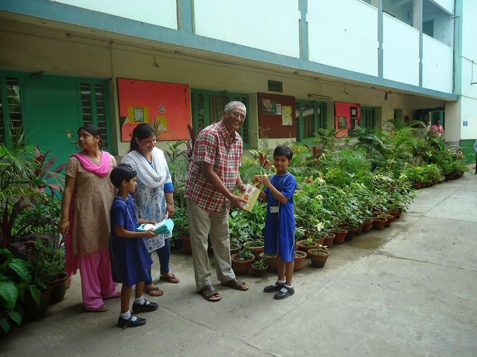 Director Fr. Franklin Menzes with schoolchildren (photo, Seva Kendra)